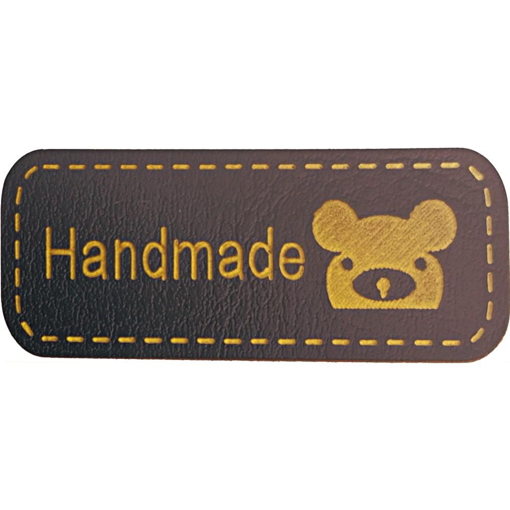 """2003 - Gelb auf braun: Aufschrift """"Handmade"""", Motiv Koalagesicht"""
