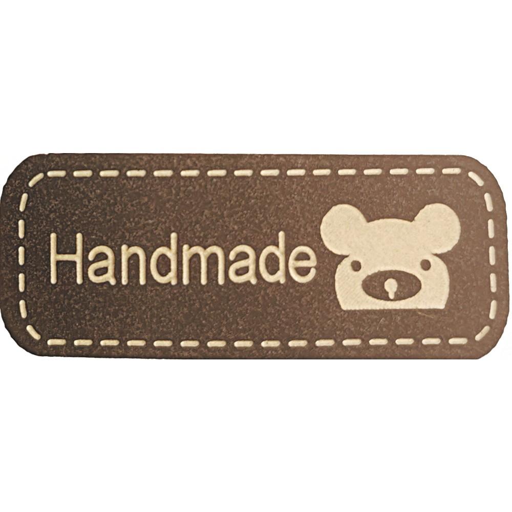 """2004 - Beige auf braun: Aufschrift """"Handmade"""", Motiv Koalagesicht"""